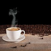 Coffee Concept - A Cup Of Espresso Coffee With Visible Steam Rising, On A Rustic Background With Fre poster