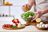 Man Cooking At Kitchen Making Healthy Vegetable Salad, Close-up, Selective Focus. Variety Of Vegetab poster