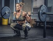 Athletic Blond Female Fitness Model Holding Heavy Barbell And Preparing For Squats. poster