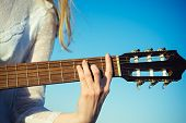 Entertainment, Guitar With Fingers Strumming Strings. Entertainment Hand Play On String Instrument O poster