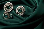 Emerald Ring And Pair Of Diamond Earrings In Gold, Wedding Jewelry With Luxury Gift Box , Close-up.  poster