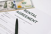 Pen And Us Dollar Banknotes Money On Rental Agreement Form Document, Ready To Sign Contract, Propert poster