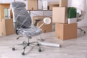 Armchair And Carton Boxes With Stuff In Room. Office Move Concept poster
