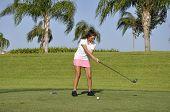 Teenage Girl Golfing