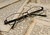 Glasses on old book pages