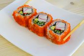 Sushi A Dish Of Traditional Japanese Cuisine Cooked From Rice, Calves Of A Salmon, Crabmeat, Avocado poster