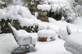 An Outdoor Patio Winter Wonderland, With Furniture, Planters, Pots And Garden Vegetation Heavily Cov poster