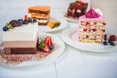 Assorted Large Pieces Of Different Cakes: Three Chocolate, Carrot, Strawberry, Chocolate. Cakes Are  poster