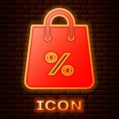 Glowing Neon Shoping Bag With An Inscription Percent Discount Icon Isolated On Brick Wall Background poster