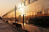 stock photo of amtrak  - An Amtrak California train leaves the station in the early morning - JPG