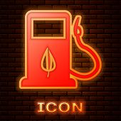 Glowing Neon Bio Fuel Concept With Fueling Nozzle And Leaf Icon Isolated On Brick Wall Background. G poster
