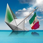 White Paper Boat With The Italian Flag That Are Sinking In A Turquoise Sea With Blue Sky And Clouds. poster
