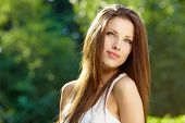 image of brown-haired  - Portrait of an young beautiful sexy woman on the nature - JPG