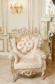 Luxurious Expensive Classic Beige Armchair With Carved Elements Stands On A Marble Floor In An Expen poster