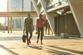 Sport Is Great For Any Age. Full Length Of Middle-aged Couple In Sports Clothing Carrying A Sports B poster