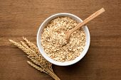Oat Flakes, Grains, Rolled Oats In Bowl On Wooden Table Background, Top View poster