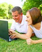 Young Caucasian Couple Using Laptop