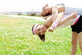 stock photo of por  - Beautiful young woman doing stretching exercise in the park - JPG