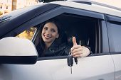 Beautiful Car Driver Woman Smiling Showing New Car Keys And Car. Caucasian Girl Sitting In Automobil poster