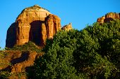 Late Afternoon Sunlight Shining On A Red Rock Mesa Called Cathedral Rock Creating Natural Shadows Su poster