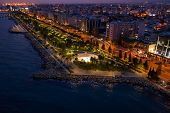 Aerial View Of Limassol Promenade Or Embankment With Alley And Buildings In Cyprus At Night. Drone P poster