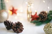 Christmas Pine Cone Or Conifer Cones Near Red Star Shape And Golden Christmas Bubble Ball On White W poster
