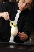 Bartender preparing cocktail.