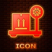 Glowing Neon Scale With Cardboard Box Icon Isolated On Brick Wall Background. Logistic And Delivery. poster