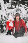 Portrait Of Happy Little Girl In Red Coat With Dad Having Fun With Snow In Winter Forest. Girl Playi poster
