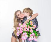 Son Giving Flowers To Mom On Birthday. Family Holiday. Boy Giving Bunch Tulips For Girl. Cute Son Gi poster