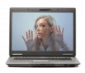 Young woman trapped in a laptop screen