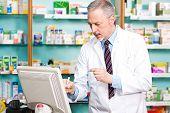 Pharmacist using a desktop computer