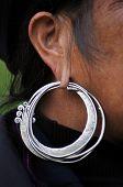 Black H'mong Vietnamese woman with a silver earring. Sapa, Vietnam