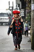 Red Dao woman walking on the streets of Sapa, Vietnam