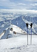 Ski Poles And Gloves In Alps
