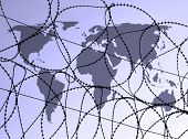 Outline map of world overlaid with razor wire.