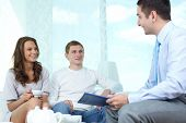 Positive family meeting with a consultant to discuss financial matters