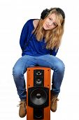 the girl  sitting on the speaker isolated on white