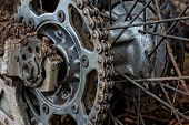 Enduro motorbike wheel and chain. Closeup shot