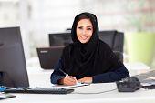 modern female Arabian office worker in office