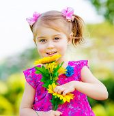 image of sunflower  - Happy baby girl playing outdoor - JPG