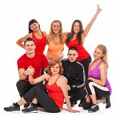 Fitness team in fitness wear standing over white background