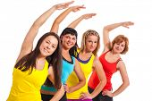 Group of women exercising over white background
