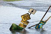 highway signs sitting in flood waters