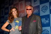LOS ANGELES - MAR 21:  Katherine Webb, Adam West arrive at the Batman Product Line Launch at the Mel