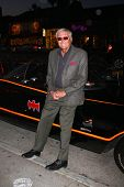 LOS ANGELES - MAR 21:  Adam West poses with the Batmobile at the Batman Product Line Launch at the M