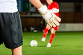 stock photo of winner man  - Man scoring a goal at indoor football or indoor soccer - JPG