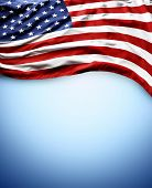 Closeup of American flag on blue background