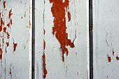 Detail Of Old Wooden Fence With Cracked Paint