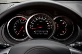 pic of speedo  - Modern car dashboard closeup with glowing arrows - JPG